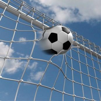 Soccer ball over blue sky