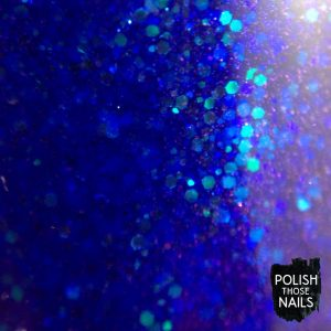 midwest-lacquer-where-bluebirds-fly-blue-glitter-swatch-bottle-macro