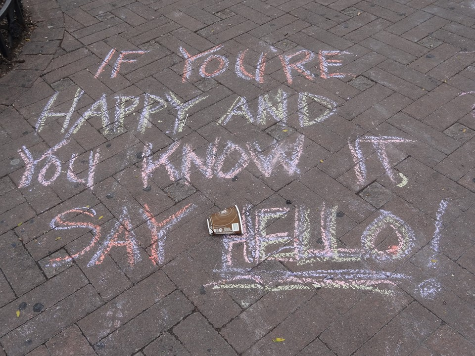 Adventure Stage Trailblazers chalk message: If you're happy and you know it, say hello.