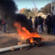 Police vehicles ablaze during Westernburg protests