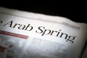 Arab Spring written newspaper.