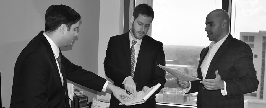 Christopher Prater, David Yaffe and Jonathan Pollard at work for their clients.