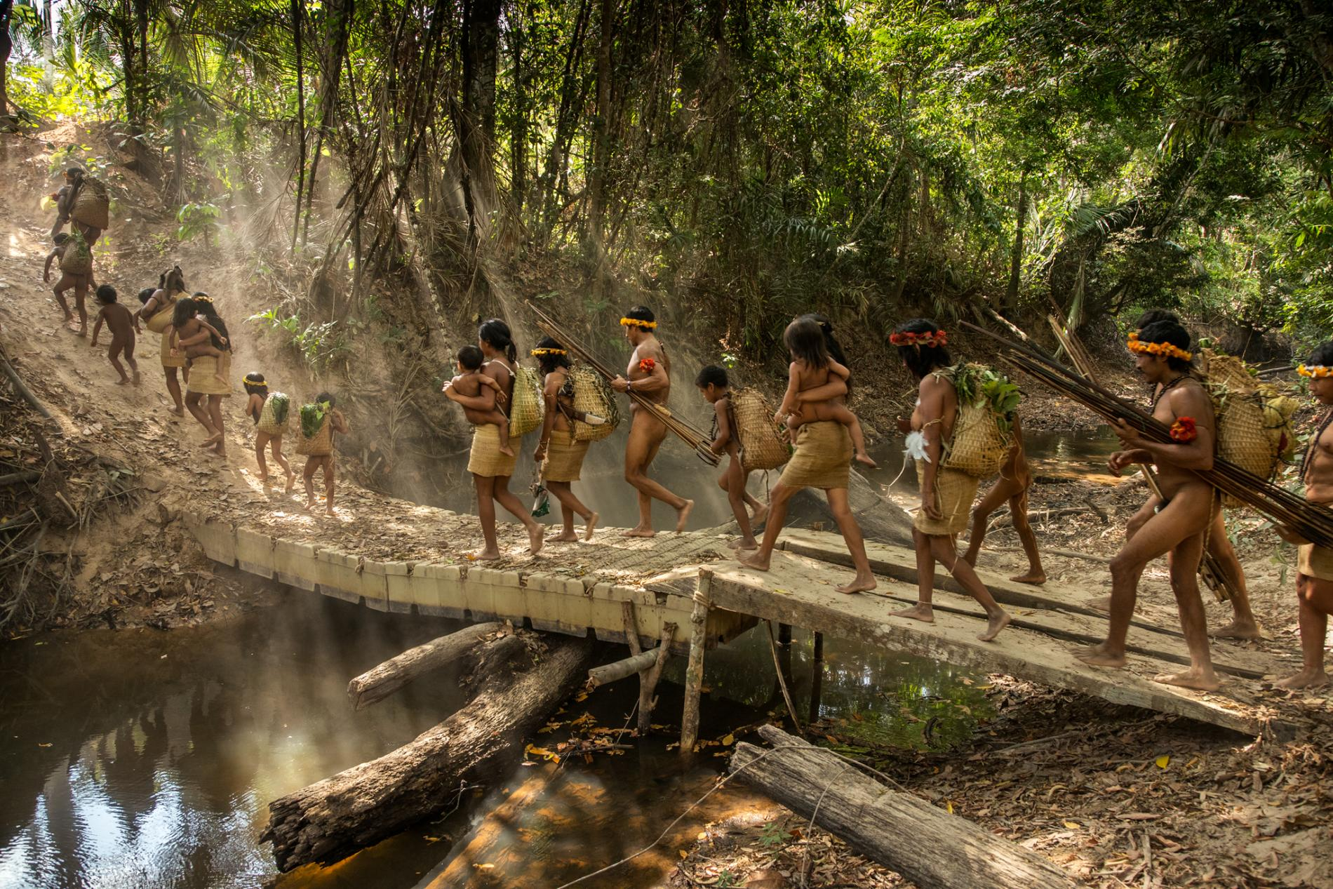 Amazon tribe out hunting. Photo by National Geographic