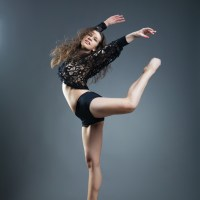 Modern style dancer posing on a studio grey background