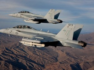 "A pair of Boeing EA-18G Growlers, XE 573 166857 and XE 571 166855 of the VX-9 ""Vampires"" cruise over the desert. Image purchased 2/14/2011  RMS 200428"