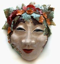 ceramic mask with poppies low fire glazes