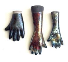 raku fired slipcast ceramic hands