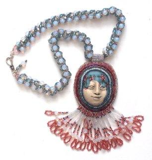 Laura Sandoval necklace made with polymer clay babushka bead