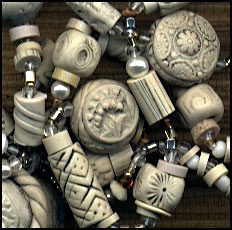 impressed beads made with faux ivory polymer clay