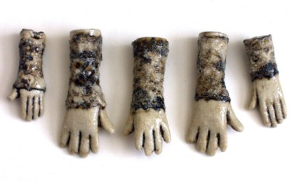 slipcast ceramic hands with lace and iron oxide