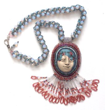 Laura Sandoval beaded necklace polymer clay face
