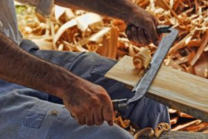 man doing wood work