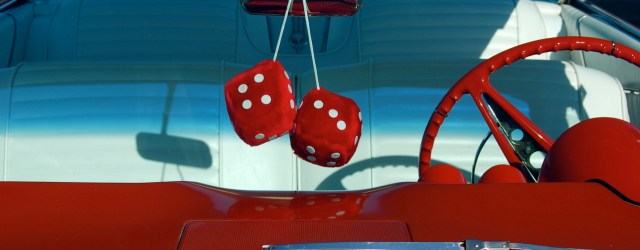 Fluffy dice in a car. Picture from freeimages.com.