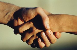 Shaking hands and language learning. Image from freeimages.com