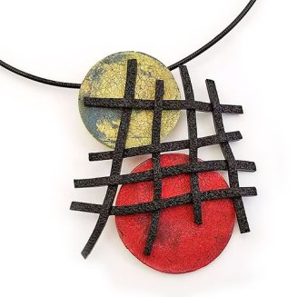 Syndee Holt gives her grid/circles combination three tries on PolymerClayDaily.com