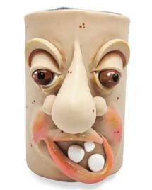 Katie Oskins' off-kilter face vase on PolymerClayDaily.com