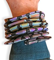 Nancy Nearing's slinky bracelet brings ideas together in a new way on PolymerClayDaily.com