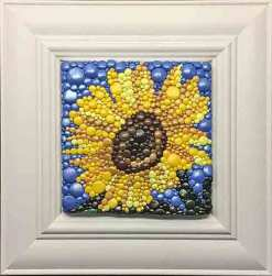 Leah Radlett rolls polymer into a pointillist sunflower on PolymerClayDaily