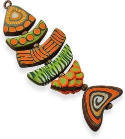 Lynn Yuhr builds her fish on beginner concepts on PolymerClayDaily.com