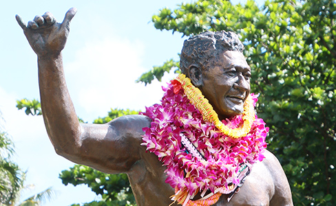 The Hamana Kalili statue welcomes people to the Polynesian Cultural Center with his worldwide-famous gesture, the shaka.