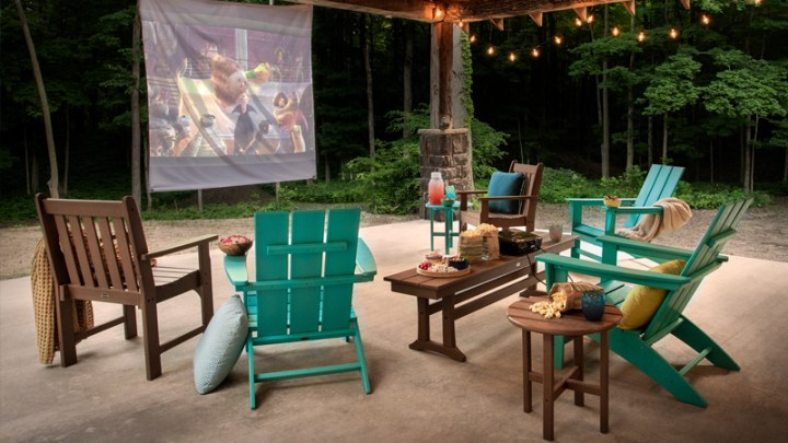 Outdoor movie night with projector and popcorn with POLYWOOD Modern Adirondack Chairs and other POLYWOOD outdoor furniture
