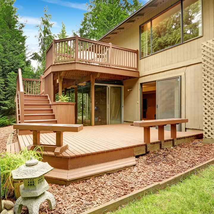 House with walkout deck and patio. Backyard view