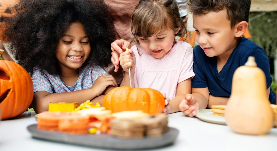 Pumpkin Carving at table with Fall treats and kids friends family
