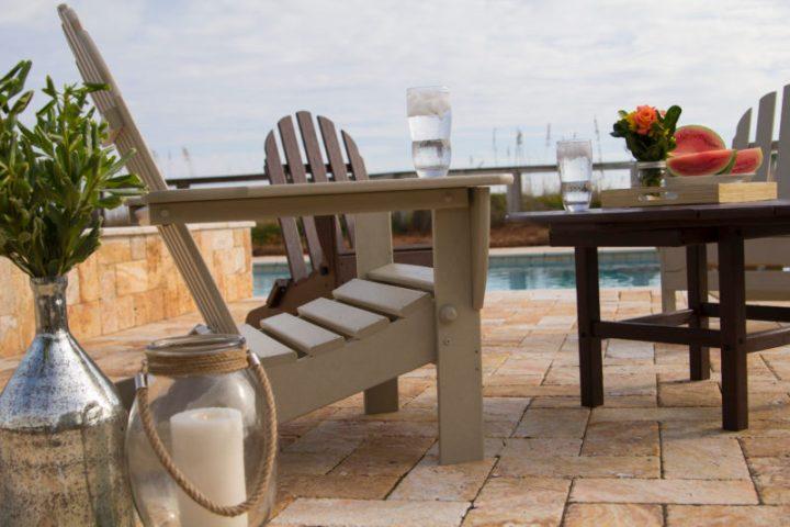 tan adirondack chair on pool patio