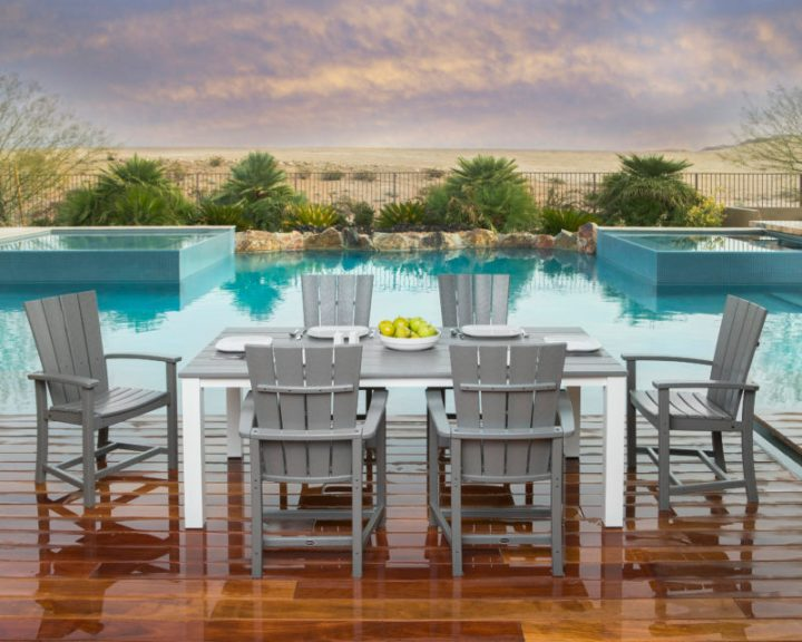 7 piece wooden dining set on a wooden pool deck