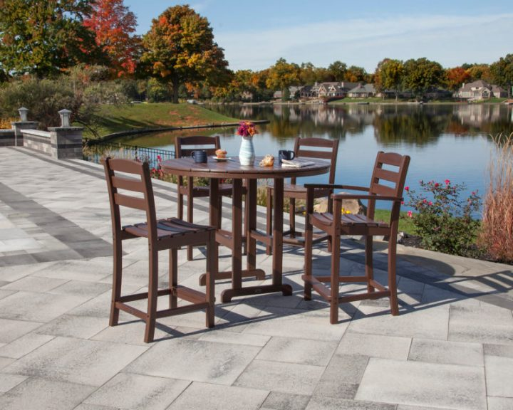 wooden bar table with chairs by lake