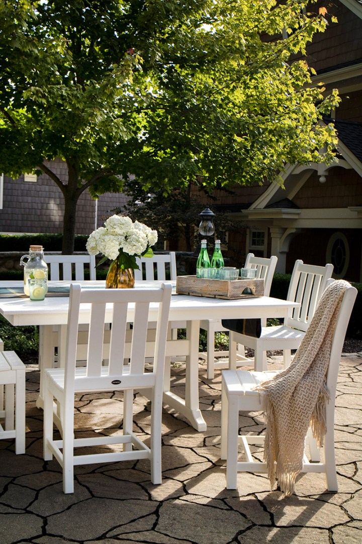 white outdoor dining table on back patio