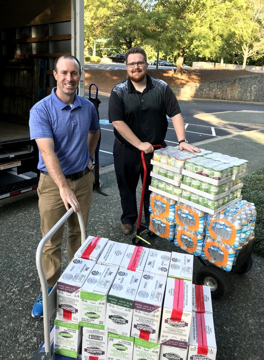 From left, Atlanta Canstruction team members Nathan Shewfelt and Dan Brace.