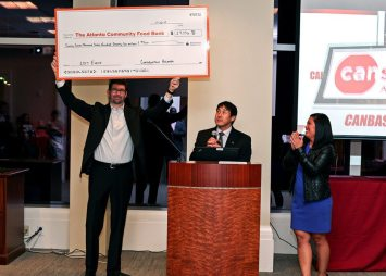 From left, Pond's Chris Jenkins, presents a check to Chris Yueh, Canstruction ATL 2017 Event Chair, and Lan Huynh.