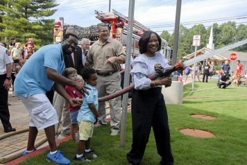 "Deputy County Manager Dr. Jackie McMorris smiles during the ceremonial ""uncoupling of the hose""."