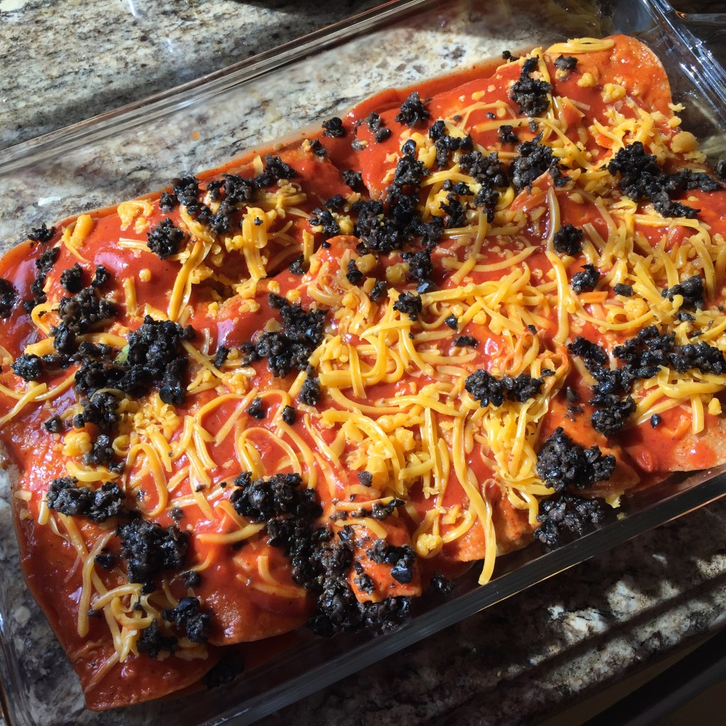 Ground Beef and Cheddar Enchiladas: All rolled up and cheesed up PLUS left over olives for contrast