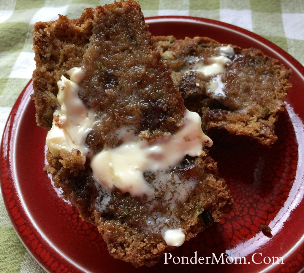 Moist Zucchini bread with chocolate chips: Sliced, warm bread PLUS butter - oh my.