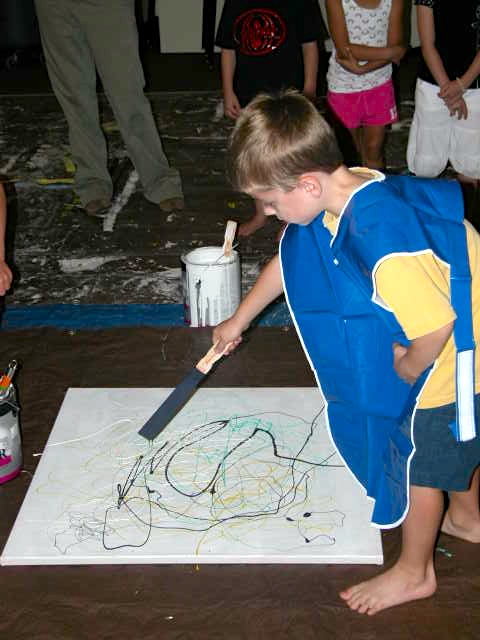 Parents Creatively Teaching Kids About Art: A young Jackson Pollock wannabe in action