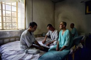 some men on rehabilitation room