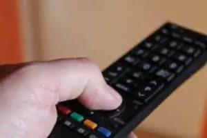 hand holding smart tv remote