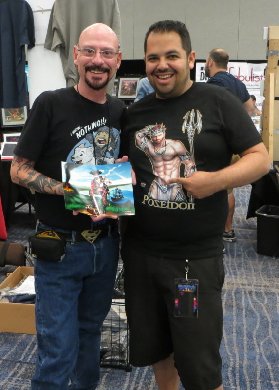 With artist Steven H Garcia and a copy of the commission I had him do.