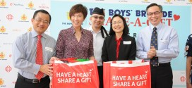 (L to R) Mr. Seah Kian Peng, CEO of NTUC FairPrice Singapore, Mrs. Josephine Teo, Senior Minister of State for Finance and Transport and Member of Parliament for Bishan-Toa Payoh GRC, Mr. Elliot Tan Vincent, Vice-President of The Boys' Brigade, Ms. Theresa Nai, Executive Vice President and Chief Operating Officer of Prudential Singapore, and Mr. Lui Chong Chee, Chairman of The BBSG 2013, having completed the packing of the food hampers for the beneficiaries.