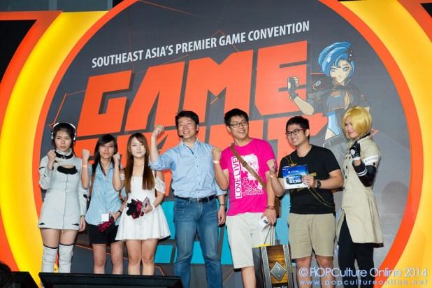 GameStart 2014 Freedom Wars Producer Junichi Yoshizawa, with fans on stage