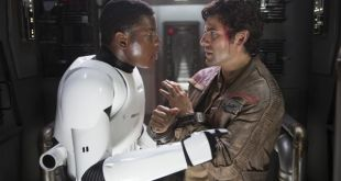 Star Wars: The Force Awakens  L to R: Finn (John Boyega) and Poe Dameron (Oscar Isaac)  Ph: David James  © 2015 Lucasfilm Ltd. & TM. All Right Reserved.