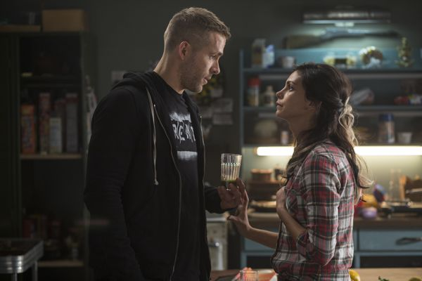 DEADPOOL Wade Wilson (Ryan Reyonlds) and new squeeze Vanessa (Morena Baccarin) trade some pointed barbs, in DEADPOOL. Photo Credit: Joe Lederer TM & © 2015 Marvel & Subs.  TM and © 2015 Twentieth Century Fox Film Corporation.  All rights reserved.  Not for sale or duplication.