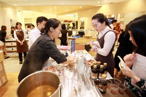 Food Japan 2016 Media Conference Exhibitors explaining to media.jpg