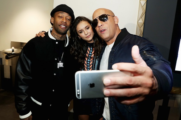 "LOS ANGELES, CA - NOVEMBER 12: Actor Vin Diesel (R), actress Nina Dobrev and rap artist Ty Dolla Sign pose for a selfie at the LA fan event of the Paramount Pictures title ""xXx: Return of Xander Cage"" at Regal LA Live on November 12, 2016 in Los Angeles, California. (Photo by Jonathan Leibson/Getty Images for Paramount Pictures International) *** Local Caption *** Vin Diesel; Nina Dobrev; Ty Dolla Sign"
