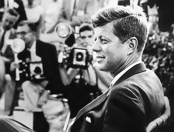August 1959: Senator John F. Kennedy during session with the press in Omaha, Nebraska. Photo, Jacques Lowe.