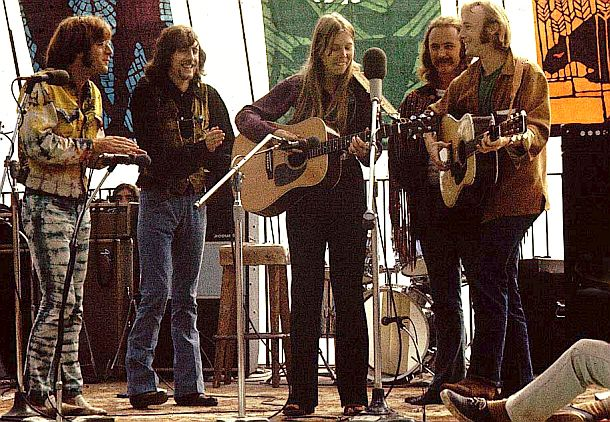 "14 Sept 1969: From left, John Sebastian, Graham Nash, Joni Mitchell, David Crosby and Stephen Stills at Big Sur Folk Festival. It appears that Joni and Stills may be having a little ""dueling guitars"" contest. Photo Robert Altman"