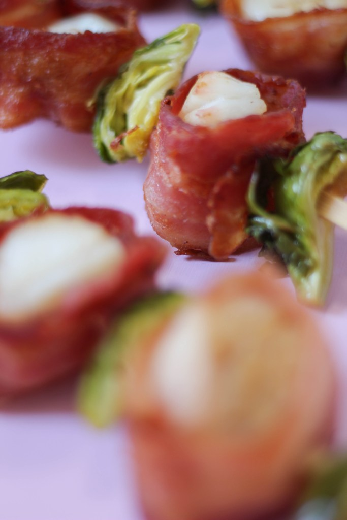 Bacon wrapped scallops and brussels sprout skewers are the perfect New Year's Eve appetizer.