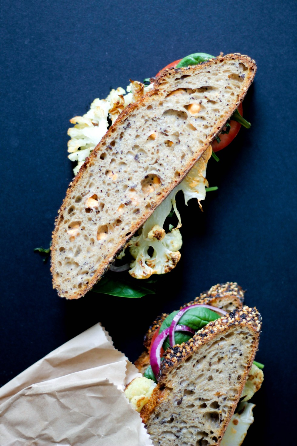 Roasted cauliflower sandwich with whipped pimento feta and apple cider vinegar reduction.